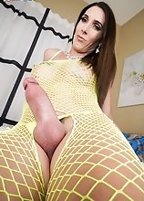 The amazing Melanie Brooks enjoys stroking her cock until she cums. Then, she tastes her cum and she loves it!