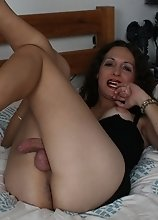 Nikki is so hot in black as she pleasures her cock with some jacking off and ass play