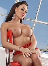 Busty hot transsexual showing her goodies